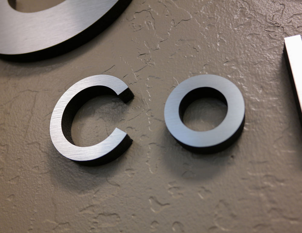 Closeup of Dibond metal dimensional lettering signage for Artisan Colour main lobby