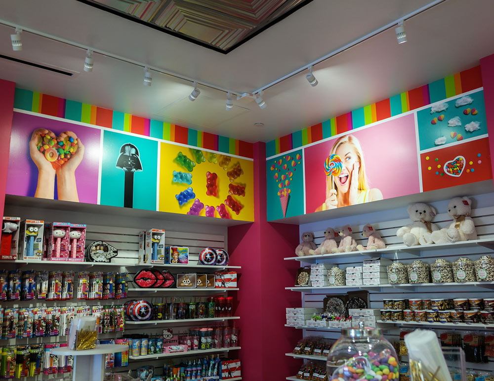 Colorful In-Store Wall Wrap Display Printed for OdySea Candy Shop by Artisan Colour