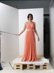 model wearing new dress in photography studio to be transposed to catalog image