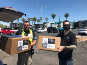 Face shields being delivered by scottsdale printer, Artisan Colour, to Phoenix Children's Hospital