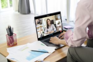 Printed Agendas and Catalogs are Essential for a Virtual Tradeshow virtual meeting with prints on the table web